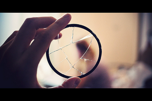 Image showing a broken UV filter - which stopped a lens being damaged