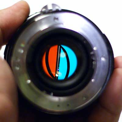Photograph of a camera lens viewed looking down the lens.