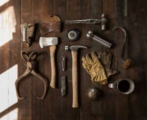 a set of carpentry tools laid out on a wooden floor
